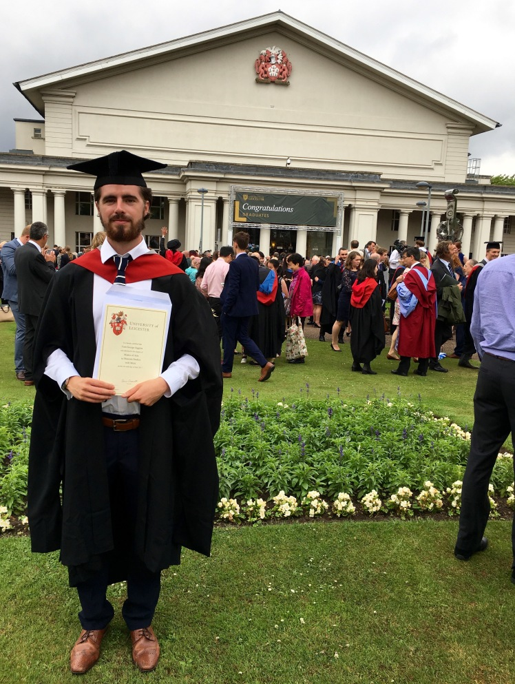 tom with his degree.jpg